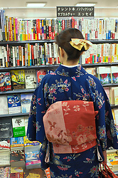 Lady in Kimono browsing in Tokyo bookshop