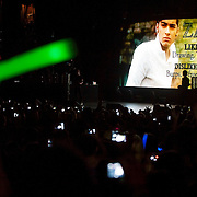 May 26, 2012 - New York, NY : Fans snap cell phone pictures and wave glowing batons as they watch an intro video featuring the bandmembers including Zayn Malik, pictured here, during a matinee performance by pop sensation 'One Direction,' at the Beacon theater in Manhattan on  Saturday afternoon. The group is on the road for their first-ever headlining North American tour in support of their debut album UP ALL NIGHT. CREDIT: Karsten Moran for The New York Times