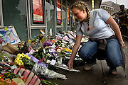 Fiona Jackson a fifteen year old schoolgirl from London lays flowers a Kings Cross station on Saturday July 9, 2005 in London , England. Three subway trains and one bus were bombed two days earlier in London on Thursday Juli 7.