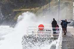 © Licensed to London News Pictures. 04/08/2015. Aberystwyth, UK. Waves crash up on the the seafront at Aberystwyth in West Wales in wet and windy conditions..  Photo credit : Jon Freeman/LNP