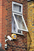 © Licensed to London News Pictures. 07/04/2013. London, UK An open window next to security devices on an upper floor. The North Korean Embassy in Ealing in West London today, 7th April 2013. The Embassy is based in a 1920's detached house in a residential area. Photo credit : Stephen Simpson/LNP