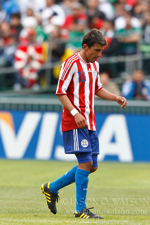 March 26, 2011; Oakland, CA, USA;  Paraguay forward Edgar Benitez (10) leaves the field during a substitution against Mexico during the second half at Oakland-Alameda County Coliseum. Mexico defeated Paraguay 3-1.