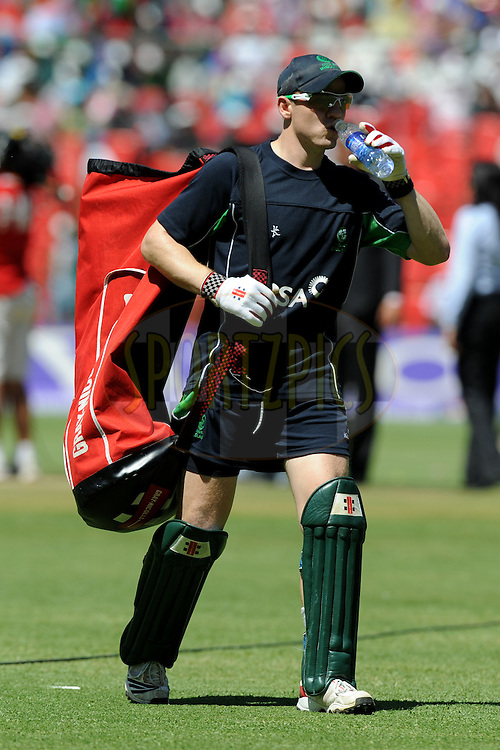 Niall O'brien of Ireland walks back after a practice session during the ICC Cricket World Cup match between  India and Ireland held at the M Chinnaswamy Stadium in Bengaluru, Bangalore, Karnataka, India on the 6 March 2011..Photo by Pal Pillai/BCCI/SPORTZPICS