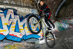 Liam Ross, 17,  does wheelie in a grafitti tunnel near London Bridge. Bikestormz is the brainchild of leader Mac Ferrari, a group of young trick cyclists who are encouraged to put knives down and enjoy the healthy, positive side of urban youth culture by joining together  and developing their cycling skills. . London, September 27 2019.