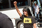 "June 13 - PHOENIX, AZ: An immigrants' rights activist from Anaheim, CA, raises a clenched fist as she arrives in Phoenix for an immigrants' rights rally and vigil Sunday. About 40 immigrants' rights activists from Anaheim, California, joined Phoenix area activists at the Arizona State Capitol Sunday for a prayer vigil and rally against SB 1070, the Arizona law that gives local law enforcement agencies the power to ask to see proof of immigration status in the course of a ""lawful contact"" and when ""practicable."" Immigrants' rights and civil rights activist say the bill will lead to racial profile. Proponents of the bill say it is the toughest local anti-immigration bill in the country and merely brings state law into line with federal immigration law.  The law, which was signed by the Arizona Governor in April, goes into effect on July 29, 2010.   Photo by Jack Kurtz"