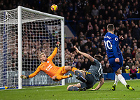 Football - 2018 / 2019 Premier League - Chelsea vs. Leicester City<br /> <br /> Eden Hazard (Chelsea FC) watches as Kasper Schmeichel (Leicester City) saves his shot and deflects it over the bar at Stamford Bridge <br /> <br /> COLORSPORT/DANIEL BEARHAM