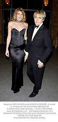 Musician NICK RHODES and MEREDITH OSTROM, at a ball in London on 12th December 2002.	PGE 69