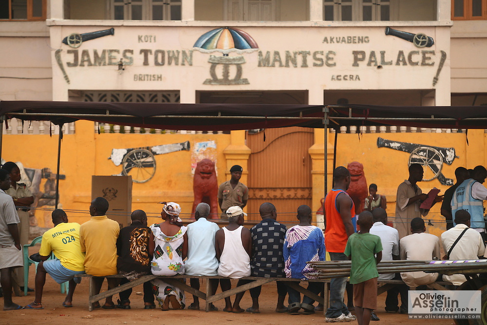 People wait outside the James Town Mantse Palace, the home of a local traditional chief, during presidential elections in Accra, Ghana on Sunday December 28, 2008.