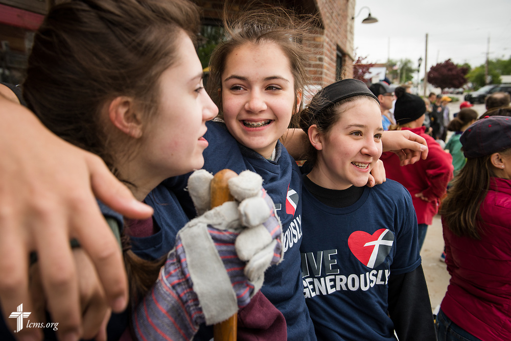 Youth volunteers (left to right) Madi Petry, Kati Petry, and Samantha Hiebsch from St. Mark's Lutheran Ministries, Eureka, Mo., enjoy fellowship during a break from filling sandbags on Monday, May 1, 2017, in downtown Eureka. The group joined other volunteers to help keep rising flood waters out of local businesses. LCMS Communications/Erik M. Lunsford