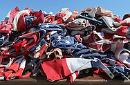 Flags sit on a table waiting to be sorted at the Springville Fire Department in Springville on Saturday, June 9, 2012. Hundreds of flags from handheld to garrison size were burned. (Stephen Mally/Freelance)