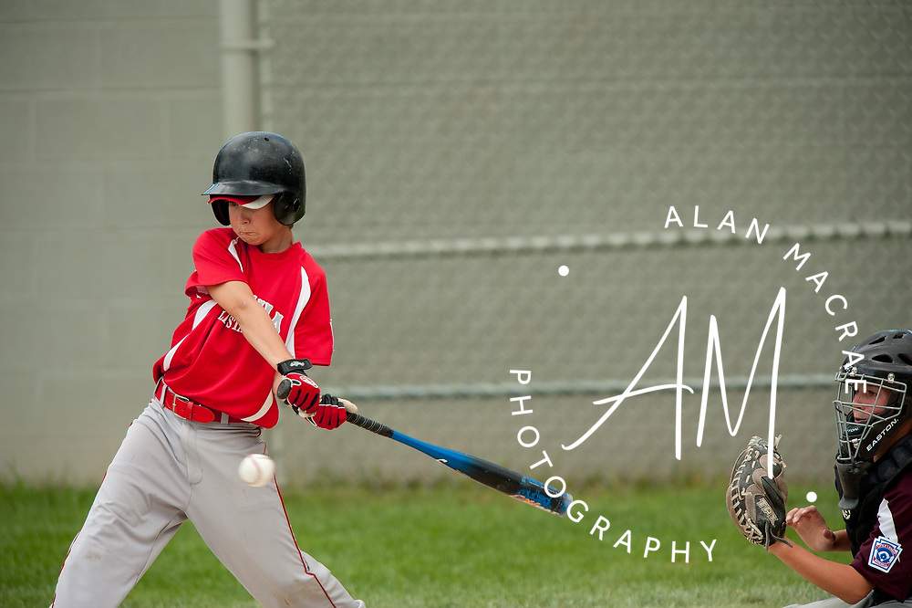 Laconia's Griffan Nyhan takes a swing during the all star championship game against Portsmouth at Laconia's Colby Field on Sunday, July 18, 2010.  (Alan MacRae/for the Citizen)