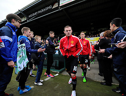 Manchester United's Wayne Rooney walks out at Huish Park to warm up  - Photo mandatory by-line: Joe meredith/JMP - Mobile: 07966 386802 - 04/01/2015 - SPORT - football - Yeovil - Huish Park - Yeovil Town v Manchester United - FA Cup - Third Round