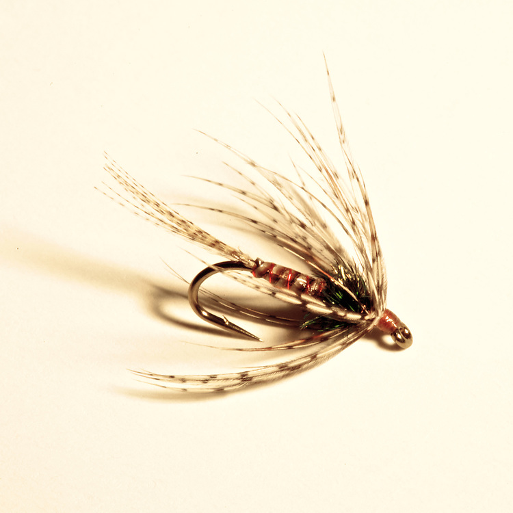 This fly imitates an emerging caddis fly. Expertly tied by Ellis Hatch.