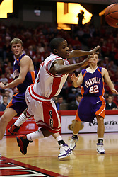 "12 January 2008: Keith ""Boo"" Richardson charges from right to left along the baseline and goes flying towards photo row after getting fouled by Pieter Van Tongeren during a game in which  the Purple Aces of the University of Evansville lost to  the Redbirds of Illinois State on Doug Collins Court at Redbird Arena in Normal Illinois by a score of 74-66."