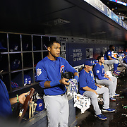 NEW YORK, NEW YORK - July 01: Addison Russell #27 of the Chicago Cubs in the dugout preparing to bat during the Chicago Cubs Vs New York Mets regular season MLB game at Citi Field on July 01, 2016 in New York City. (Photo by Tim Clayton/Corbis via Getty Images)
