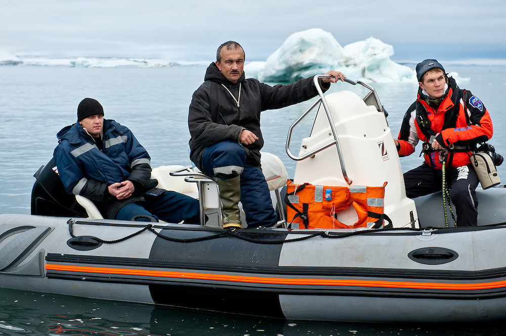 Roman Iskhakov, right, a Russian tourist, aboard a Zodiac boat in Franz Josef Land, Russian Arctic.