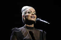 Lily Allen performing close up