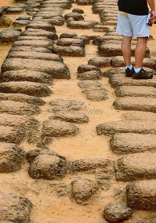 Sand between the large stone boulders used to make the path to one of the great temples in cambodia