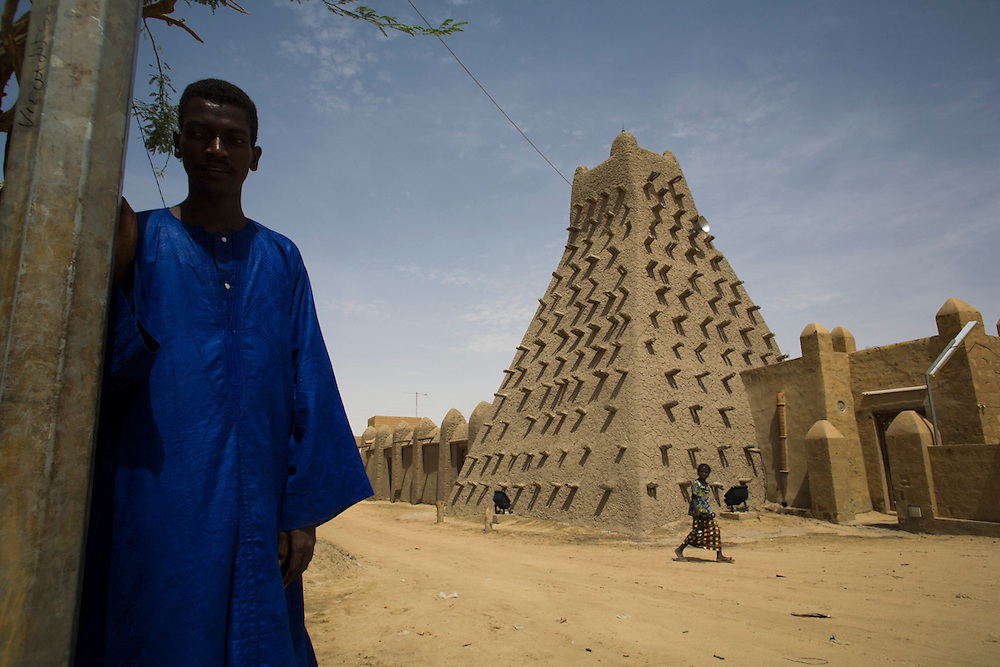 A man stands near Sankor�osque, in Timbuktu, Mali.