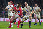 Twickenham, Surrey. UK.  Chris ROBSHAW, look's on as Antony WATSON, wrap's up, Josh ADAMS, during the Six Nations Rugby Match, England vs Wales RFU Stadium, Twickenham. Surrey, England. on Saturday 10.02.18<br /> <br /> <br /> [Mandatory Credit Peter SPURRIER/Intersport Images]