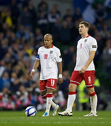 DUBLIN, REPUBLIC OF IRELAND - Wednesday, May 25, 2011: Wales' captain Robert Earnshaw and Sam Vokes look dejected as Scotland score the second goal during the Carling Nations Cup match at the Aviva Stadium (Lansdowne Road). (Photo by David Rawcliffe/Propaganda)