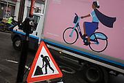 Barclays bike service van and street roadworks sign
