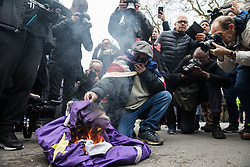 London, UK. 31 January, 2020. Brexit supporters burn an EU flag in Whitehall on Brexit Day.