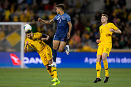 CANBERRA, AUSTRALIA - OCTOBER 10: Australian defender Mark Milligan (5) heads the ball under pressure from Nepal midfielder Abhishek Rijal (7) during the FIFA World Cup Qualifier soccer match between Australia and Nepal on October 10, 2019 at GIO Stadium in Canberra, Australia. (Photo by Speed Media/Icon Sportswire)