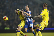 Leeds United defender Charlie Taylor (21) holds off Brighton & Hove Albion centre forward Glenn Murray (17) during the EFL Sky Bet Championship match between Brighton and Hove Albion and Leeds United at the American Express Community Stadium, Brighton and Hove, England on 9 December 2016.