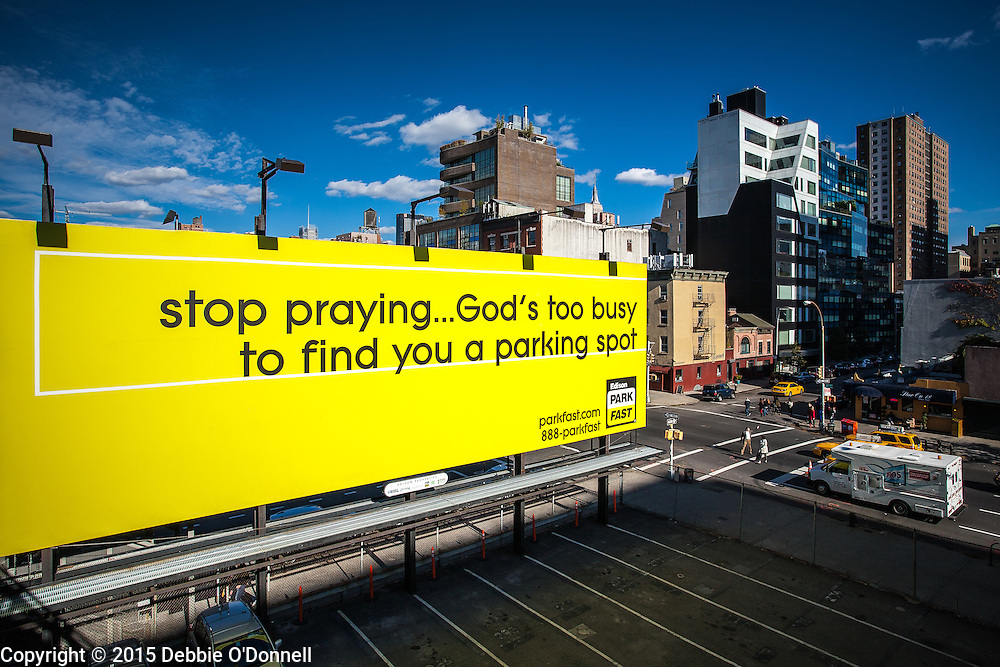 A witty colorful billboard on 10th Avenue and 18th Street, New York,  advertising parking space.