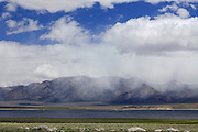 Rain clouds over the White Mountains and Crowley Lake.  California.  USA.