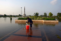 July 4, 2018 - Lahore, Punjab, Pakistan - A view of rain water accumulated at Greater Iqbal Park in front of historical Badshahi Mosque and Minar-e-Pakistan after the intense monsoon rains in Lahore on July 04, 2018. The ongoing pre-monsoon rain spell has once again hit the city death toll in over the past two days has risen to 15 with more than 50 people reportedly being injured in rain-related incidents. Choked drains, broken roads and faulty wiring have led to enormous damage and loss of life and property. The Met Office has said that due to high pressure monsoon currents penetrating in the country, the Punjab capital, as well as other cities. (Credit Image: © Rana Sajid Hussain/Pacific Press via ZUMA Wire)