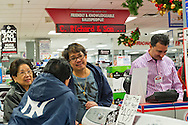 Nov. 23, 2012 - Bellmore, New York, U.S. - On Black Friday, the big shopping day after Thanksgiving, these customers are shopping locally at P.C. Richard & Son, an appliance and electronics chain that has sales and is decorated for the winter holidays. PC Richard & Son has been a local presence in Bellmore, Long Island, since 1953.