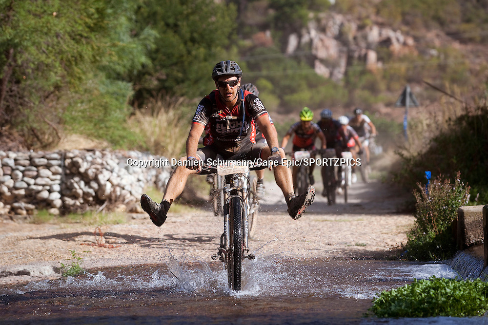 Tod Horton keeps his feet dry during stage 4 of the 2015 Absa Cape Epic Mountain Bike stage race from HTS Drostdy in Worcester, South Africa on the 19 March 2015<br /> <br /> Photo by Damien Schumann/Cape Epic/SPORTZPICS<br /> <br /> PLEASE ENSURE THE APPROPRIATE CREDIT IS GIVEN TO THE PHOTOGRAPHER AND SPORTZPICS ALONG WITH THE ABSA CAPE EPIC