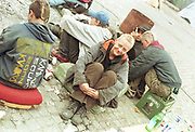 Sunja, sitting with friends on the street , Dresden, Germany, 2000's,