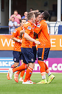 Alex Lacey of Luton Town (2nd right) celebrates scoring the opening goal during the Pre Season Friendly match at Kenilworth Road, Luton<br /> Picture by David Horn/Focus Images Ltd +44 7545 970036<br /> 26/07/2014
