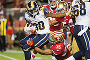 San Francisco 49ers free safety Eric Reid (35) tackles Los Angeles Rams running back Todd Gurley (30) at Levi's Stadium in Santa Clara, Calif., on September 12, 2016. (Stan Olszewski/Special to S.F. Examiner)