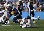 Dec 31, 2017; Carson, CA, USA; Los Angeles Chargers wide receiver Keenan Allen (13) is defended by Oakland Raiders middle linebacker NaVorro Bowman (53) during an NFL football game at StubHub Center.