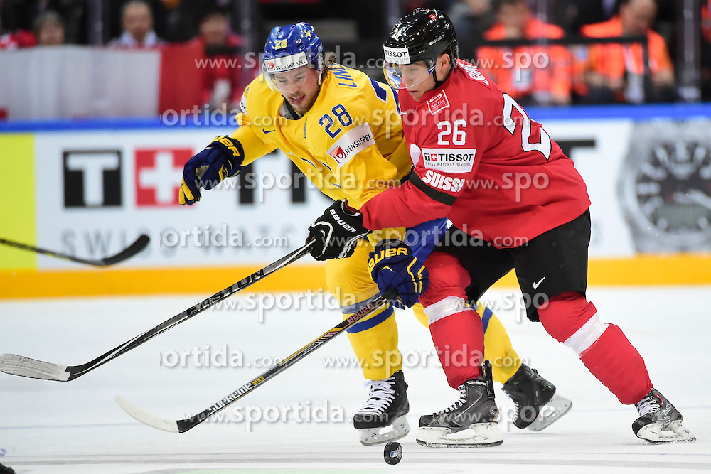 09.05.2015, O2 Arena, Prag, CZE, IIHF, WM, Schweden vs Schweiz, Gruppenphase, im Bild 0 Elias Lindholm (SWE) Reto Suri (SUI) // during the IIHF Icehockey World Championships Groupstage Match between Sweden and Switzerland at the O2 Arena in Prag, Czech Republic on 2015/05/09. EXPA Pictures &copy; 2015, PhotoCredit: EXPA/ Freshfocus/ Andy Mueller<br /> <br /> *****ATTENTION - for AUT, SLO, CRO, SRB, BIH, MAZ only*****