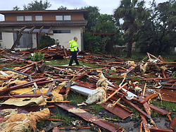 Palm Bay officer Dustin Terkoski walks over debris from a two-story home at Palm Point Subdivision in Brevard County after a tornado touched down on Sunday, September 10, 2017. Photo by Red Huber, Orlando Sentinel/TNS/ABACAPRESS.COM