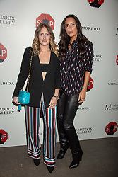Left to right, Rosie Fortescue and Lily Fortescue at 'Shadowman' Richard Hambleton Private View and After Party hosted by Andy Valmorbida and Maddox Gallery, held at 26 Leake Street Tunnels, London SE1 England. 12 September 2018.