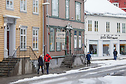 Street scene Fiske Compagniet Restauration restaurant and Arctic Polare shop in Storgata in Tromso, Arctic Circle, Northern Norway