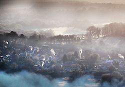 © Licensed to London News Pictures. 05/01/2017. Chilworth UK.  Smoke and mist swathe Chilworth in the North Downs at sunrise.  A continuing cold spell has seen temperatures as low as -6 in some areas. Photo credit: Peter Macdiarmid/LNP