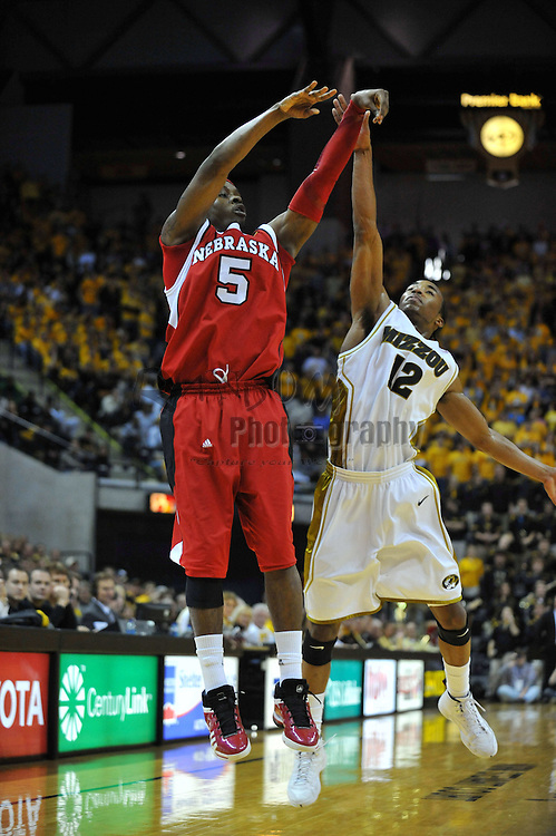 Jan 23, 2010; Columbia, MO, USA; Nebraska Cornhuskers guard Sek Henry (5) goes up for a shot as Missouri Tigers guard Marcus Denmon (12) attempts to block in the first half at Mizzou Arena in Columbia, MO. Missouri won 70-53. Mandatory Credit: Denny Medley-US PRESSWIRE