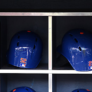 The batting helmet of Yoenis Cespedes (left), next to Lucas Dudas' in the Mets dugout before the New York Mets Vs Washington Nationals. MLB regular season baseball game at Citi Field, Queens, New York. USA. 1st August 2015. (Tim Clayton for New York Daily News)