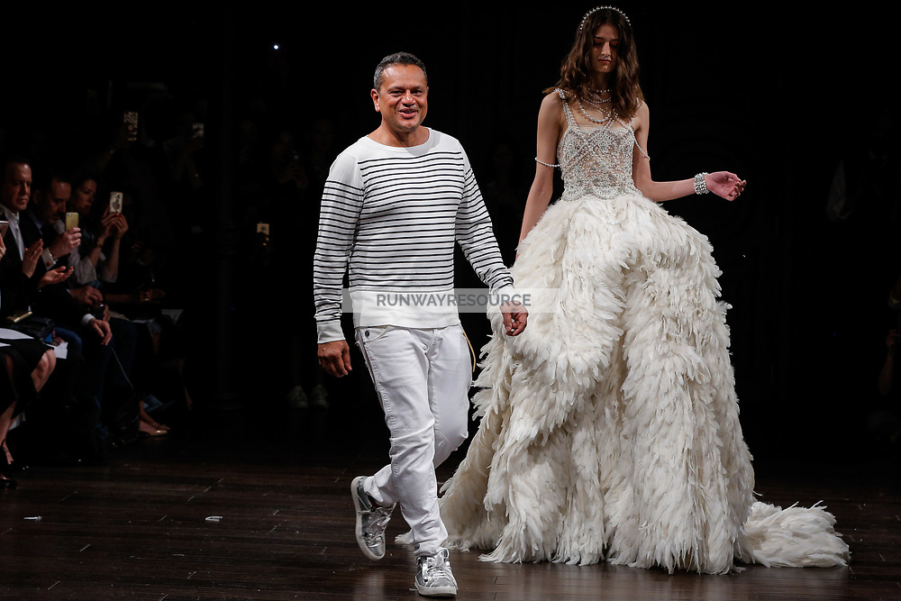 Naeem Khan and Daniela Aciu walk the runway after presenting the Naeem Khan Bridal Spring 2018 Collection
