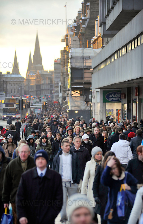 EDINBURGH, UK - 23rd December 2010:  Shoppers hit the streets of Edinburgh today in what is expected to be the busiest day of the year for retailers in 2010.  Credit card company Visa Europe is expecting to process 26.5m transactions worth more than £1.2bn, as Britons rush to buy last-minute Christmas presents.  Pictured shoppers on Princes Street.  (Photograph: Callum Bennetts/MAVERICK)