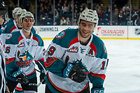 KELOWNA, CANADA - FEBRUARY 20: Dillon Dube #19 of the Kelowna Rockets smiles as he skates to the bench to celebrate a goal against the Prince George Cougars  on February 20, 2018 at Prospera Place in Kelowna, British Columbia, Canada.  (Photo by Marissa Baecker/Shoot the Breeze)  *** Local Caption ***