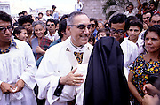 The martyr Archbishop Oscar Romero of El Salvador is greeted by an Catholic nun and several hundred of the faithful after a mass at Iglesia el Rosario -the Church of the Rosary - in San Salvador, El Salvador. The priest was later slain at the alter by a right wing gunman in 1980. Óscar Arnulfo Romero y Galdámez was a bishop of the Catholic Church in El Salvador. He became the fourth Archbishop of San Salvador, succeeding Luis Chávez, and spoke out against poverty, social injustice, assassinations and torture. Romero was assassinated while offering Mass on March 24,1980. To license this image, click on the shopping cart below -