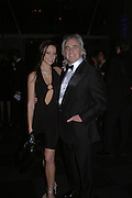 Peter Stringfellow and Bella Wright. The Black and White Winter Ball. Old Billingsgate. London. 8 February 2006. -DO NOT ARCHIVE-© Copyright Photograph by Dafydd Jones 66 Stockwell Park Rd. London SW9 0DA Tel 020 7733 0108 www.dafjones.com